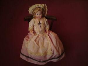 Vintage French Celluloid Brittany Christianity Doll with Wooden Rocking Chair
