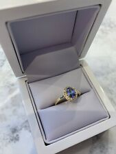Oval Cut Lilac Sapphire Ring With Diamond Halo Set On Yellow Gold