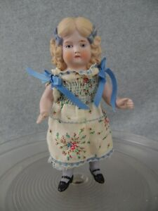 "8"" vintage all bisque character girl doll with blonde hair and blue hair bows"