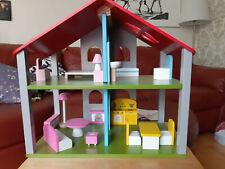 Puppenhaus aus Holz mit Zubehör wie neu