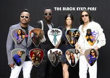 The Black Eyed Peas Guitar Picks On Photographic Background 10 Guitar Picks