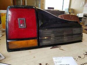 DRIVER TAIL LIGHT WITHOUT QUAD 4 APPEARANCE PKG BLACK TRIM FITS CALAIS 260970