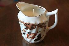 Redfearn and Drakeford milk jug candle, orange flower black leaf vanilla wax