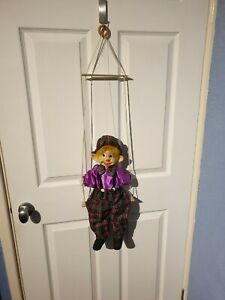 Clown Marionette on a Swing Dressed in Tartan Trousers, Hat and Bow Tie - Mint
