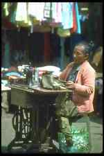 083050 Woman Sewing Clothes On Street In Front Of Shop Gianyar A3 Photo Print