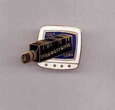 Pin's Société éléctronique Inspectronic 1964 - 1992 (caméra, Télévision) EGF