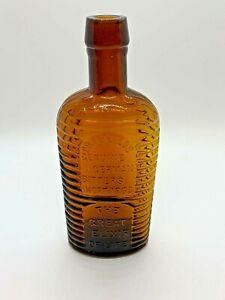 Circa 1880s Amber Dr. Petzold's Genuine German Bitters Cabin Elixir Bottle