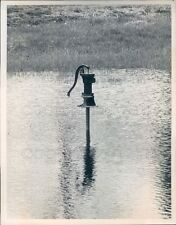 1967 Press Photo Well With Hand Pump Surrounded by Flood Water