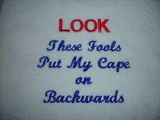 funny captions.... fools put my cape on backwards   baby bibs