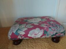 LARGE FOOT STOOL, WITH FLORAL MATERIAL & WOODEN LEGS.IN NICE CONDITION.