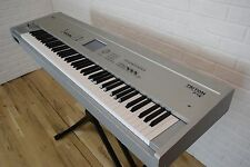 Korg Triton Pro-X 88 keyboard synthesizer near MINT-used 88 key piano for sale