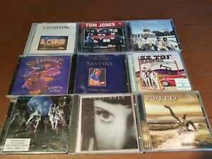 ASSORTED CAT STEVENS SANTANA TOM JONES CANNED HEAT ZZ TOP FOREIGNER MUSIC CDS