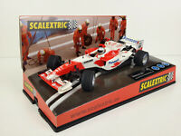 Slot car SCX Scalextric 6174 Toyota F1 TF104 Interlagos #16 Jarno Trulli