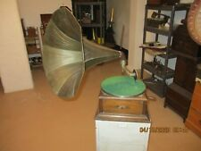 A good working  horn gramophone phonograph with needles and records The Leader