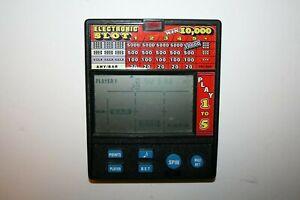 VINTAGE Radio Shack LCD Electronic Slot SLOTS Handheld Travel Game Model 60-2419