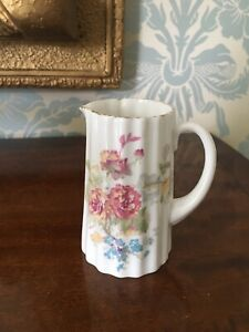 ROYAL DOULTON SMALL JUG DECORATED WITH FLOWERS