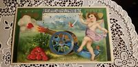 ANTIQUE HTL HOLD TO LIGHT VALENTINE POSTCARD CUPID W/ CANNON shooting hearts