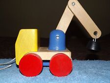WOOD PULL TOY TOW TRUCK MAGNETIC SWIVELS & BENDS RED YELLOW & BLUE HANDCRAFTED