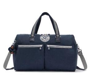 New! Kipling Itska Striped Web Blue Duffle Bag Traver Weekend Logo Charm w/tag