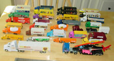Your choice of 41 Hot Wheels, Racing Champions, Road Champions trucks trailers
