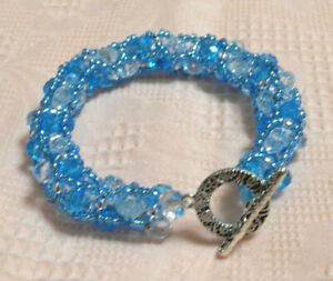 Exclusive, unique handmade blue and white beaded bracelet, bijouterie