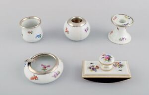 Five parts Meissen porcelain with hand-painted floral motifs and gold decoration