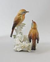 9997647 Porzellan Figur Vogel Rotkehlchen mit Nest Ens H15cm