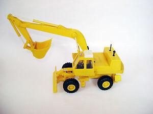 Excavator digger EO-4321 ATEK-881 plastic model O&K MH City clone 1/43 USSR