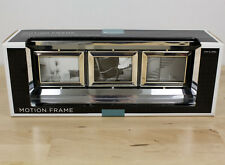 """TARGET Home Mirror Motion Frame Picture Frame Holds 3 Pictures 3"""" x 2-7/16"""""""