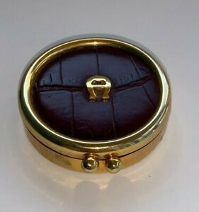 Etienne Aigner, Gold Metal Pill Box with Burgundy Leather Inlay