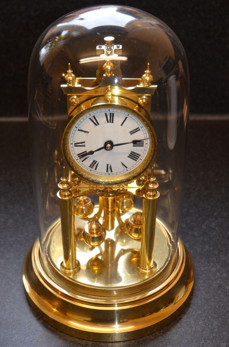 G A Antique Clocks and Rare Books