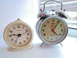 Two vintage alarm clocks. Soviet and Chinese 1970-80