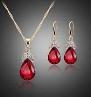 Yellow gold finish pearcut Ruby & cluster created diamond pendant and earrings
