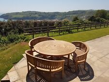 round 150 teak table with 6 stacking chairs