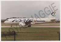Colour print of Adria Airways Airbus A320 S5-AAC at Manchester in 1999