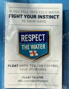 """RNLI,  LIFEBOAT - PIN- BADGE ;  """"Respect the Water"""""""