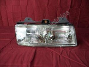 NOS OEM Pontiac Trans Sport, Silhouette, Lumina APV Headlight 1990-93 Right Hand