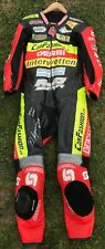 DOMINIQUE AEGERTER RACE WORN AND SIGNED 125CC AJO DERBI 2009 LEATHERS MOTOGP.