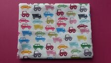1 metre of polycotton with various vehicles in bright colours on white