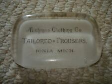 1900's rectangle glass paperweight Michigan clothing Co. Ionia Tailored Trousers