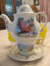 Disney Parks Alice in Wonderland Teapot with cup and saucer.Stackable