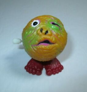 """Working 1986 Soma 2.25"""" Orange Jumping Zombie Monster Ball Wind-Up Toy Madballs"""