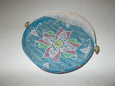 Vintage handmade painted bug netting covered outdoor thatched picnic basket bowl
