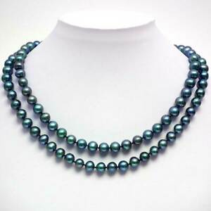 Gorgeous 43-inch long teal blue freshwater pearl necklace with silver clasp