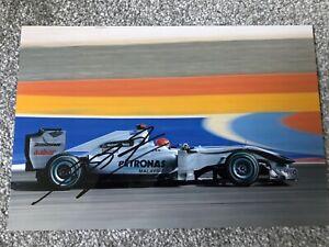 Michael Schumacher Formula 1 Motor Racing Hand Signed 12x8 Photo. Authentic