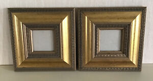 A PAIR OF SMALL VINTAGE WOODEN PICTURE / PHOTO FRAMES / WITH AN AGED GOLD FINISH