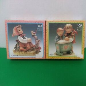 2 New M.I. Hummel  100 Piece Puzzles. (In Tune And Blessed Event )7 X 7 Sealed