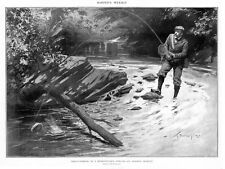 TROUT FISHING IN A PENNSYLVANIA STREAM FISHERMAN HAS TROUT ON HIS LINE CREEL NET