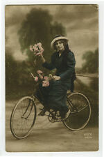 c 1914 Young LADY on BICYCLE tinted photo postcard