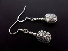 A PAIR OF TIBETAN SILVER DANGLY EARRINGS WITH 925 SOLID SILVER HOOKS. NEW..